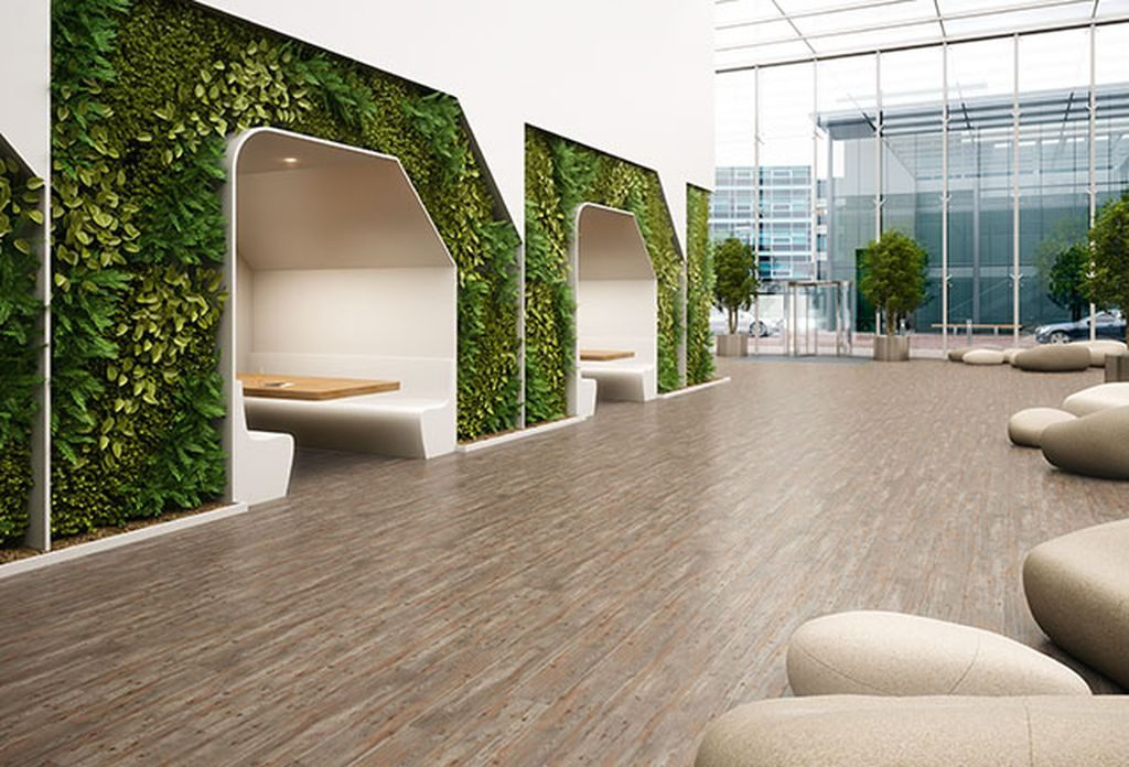 Commercial flooring - an image of a flooring solution in a beautiful and green enhanced lobby area.